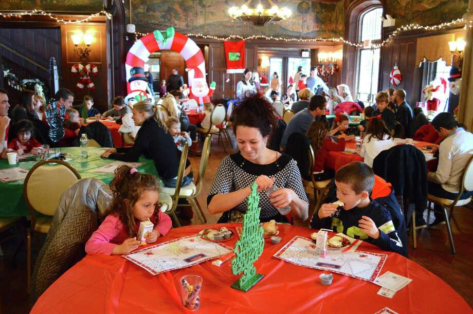 Adriana Delev of New Canaan and her children, Vanessa, 4, and Leonardo, 6, enjoy Breakfast with Santa, Saturday, Dec. 16, 2017, at Waveny House in New Canaan, Conn. Photo: Jarret Liotta / For Hearst Connecticut Media / New Canaan News Freelance