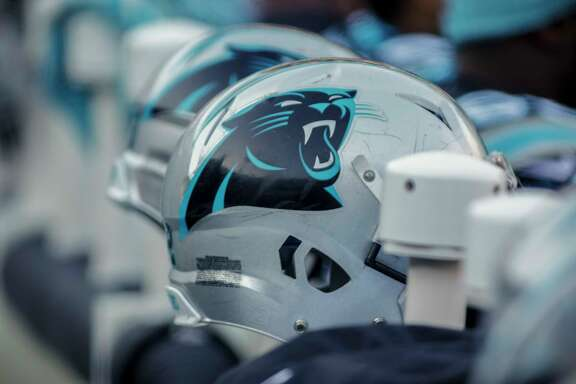 Carolina Panthers' helmets sit warm and ready on the bench during the second half of an NFL football game against the Minnesota Vikings in Charlotte, N.C., Sunday, Dec. 10, 2017. The Panthers won 31-24. (AP Photo/Bob Leverone)