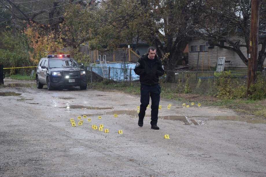 A stolen vehicle was shot at more than 30 times Monday morning on the South Side, prompting a police investigation and a search for the suspects responsible. Photo: Caleb Downs / San Antonio Express-News
