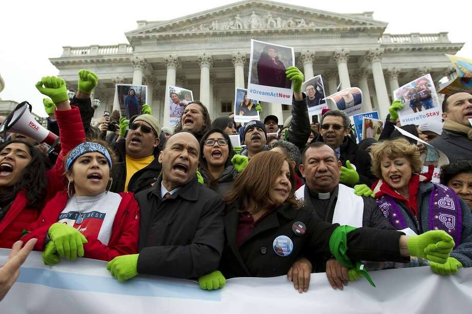 In this De. 6, 2017 photo, Rep. Luis Gutierrez D-Ill., third from left, along with other demonstrators protest outside of the U.S. Capitol in support of the Deferred Action for Childhood Arrivals (DACA), and Temporary Protected Status (TPS), programs, during an rally on Capitol Hill in Washington.  House and Senate Democrats stand divided over whether to fight now or later about the fate of some 800,000 young immigrants who came to the U.S. illegally as children. ( AP Photo/Jose Luis Magana) Photo: Jose Luis Magana, Associated Press
