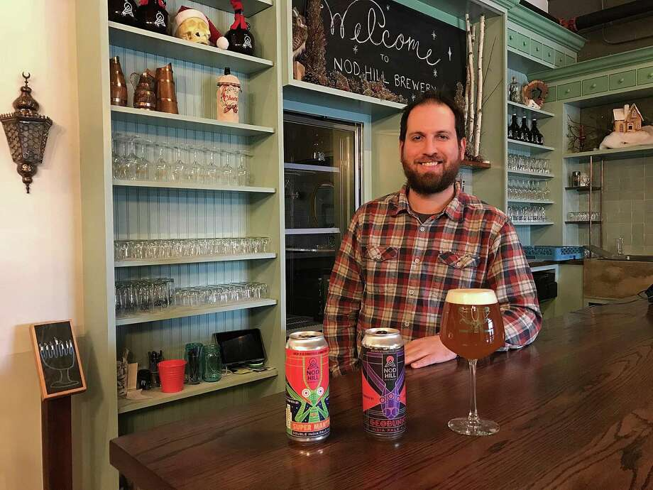 David Kaye of Nod Hill Brewery stands behind cans of Geobunny IPA and Super Mantis Double IPA, the brewery's first can releases, in Ridgefield, Conn., on Monday, Dec. 18, 2017. Photo: Chris Bosak / Hearst Connecticut Media / The News-Times