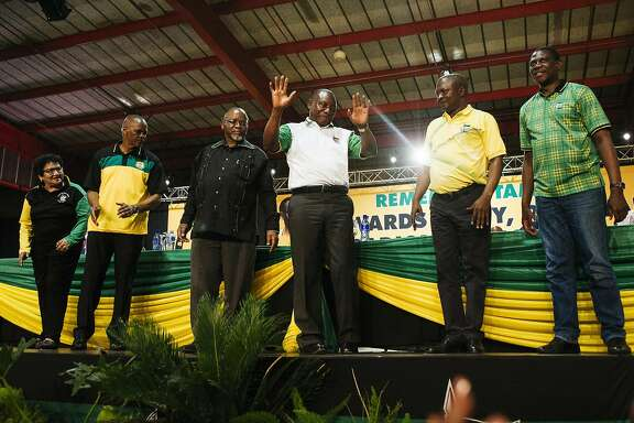 Cyril Ramaphosa, South Africa's deputy president and newly elected president of the African National Congress party (ANC), center, gestures on stage during the 54th national conference of the African National Congress party in Johannesburg, South Africa, on Monday, Dec. 18, 2017. With his election as leader of the ruling African National Congress on Monday, Ramaphosa, 65, will be the party's presidential candidate in 2019 and may take over running the country from�Jacob Zuma�sooner than that if he's ousted before the end of his second term. Photographer: Waldo Swiegers/Bloomberg