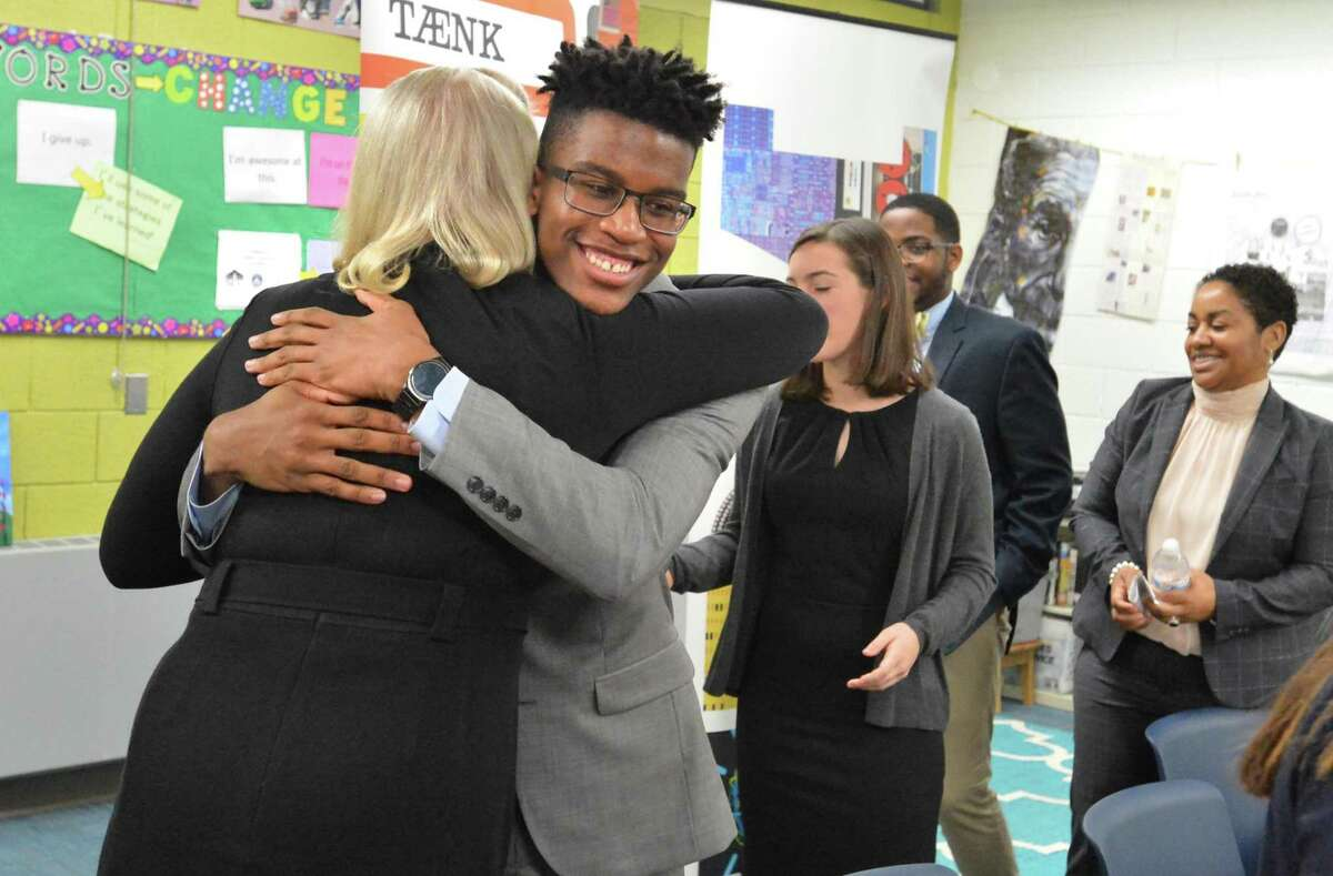 IBM Ceo Ginny Rometty gets a hug from Katrell Clay as Ivanka Trump, White House advisor and daughter of President Donald Trump, spoke with students at the Norwalk Early College Academy at Norwalk High School on Monday December 18, 2017 in Norwalk Conn. NECA is part of a growing network of P-TECH schools, an innovative education model developed by IBM to better equip youth with skills to succeed in college and career. Ivanka Trump and IBM CEO Ginni Rometty spoke with a half-dozen students during a panel discussion to highlight the importance of modern skills and career education.
