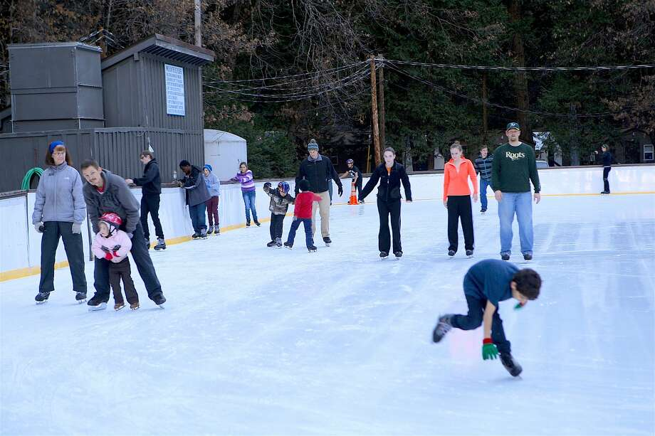 The reopening of the ice rink, with a view of Half Dome, has provided Yosemite Valley with the feel of the Christmas-New Year's holiday even without the usual seasonal blanket of snow. Photo: Tom Stienstra, Tom Stienstra / The Chronicle