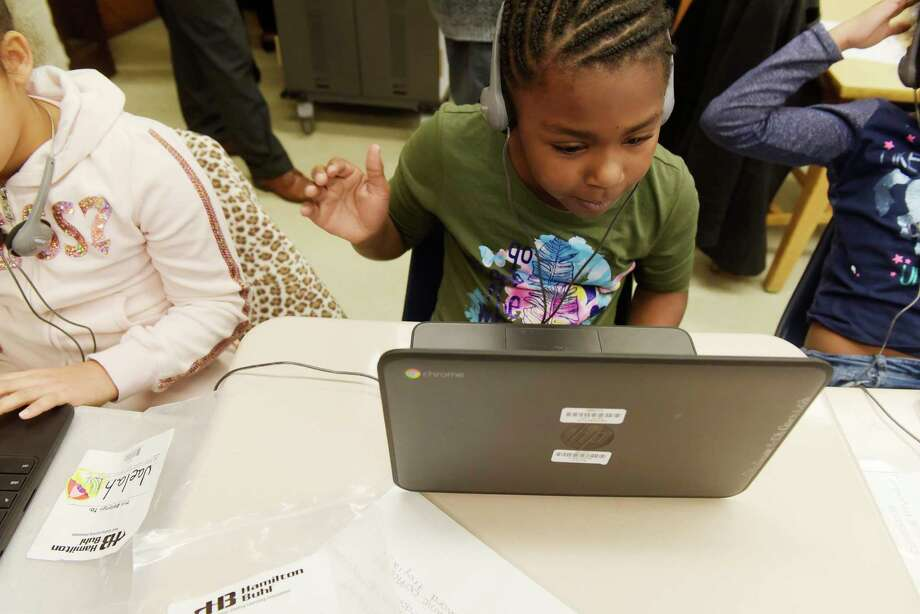 Carroll Hill School third grader, Naziah Gordon works on a coding lesson on Monday, Dec. 18, 2017, in Troy, N.Y.  School-wide children took part in the program called an Hour of Code.   (Paul Buckowski / Times Union) Photo: PAUL BUCKOWSKI, Albany Times Union / 20042435A