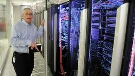 BP's Keith Gray, director of technical computing and the Center for High Performance Computing, talks about the company's computing power during a tour of the facilities Wednesday May 20, 2015.(Dave Rossman photo)