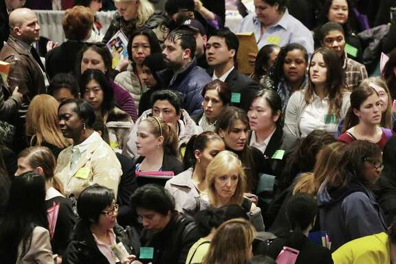 File photo of job fair in New York. The economy is booming, the job market is tight and the unemployment rate stands at 4.1 percent. What a contrast to the dark days of the recession, when companies shed jobs at a horrifying rate.