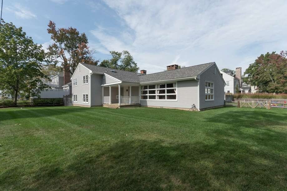 The contemporary house at 12 Baywater Drive in the Noroton Bay neighborhood has panoramic water views from its corner lot on Long Island Sound. Photo: Contributed Photos