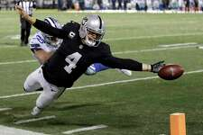 Oakland Raiders quarterback Derek Carr (4) fumbles the ball into the end zone in front of Dallas Cowboys strong safety Jeff Heath (38) during the second half of an NFL football game in Oakland, Calif., Sunday, Dec. 17, 2017. The play was ruled a touchback and the Cowboys got possession. The Cowboys won 20-17. (AP Photo/Ben Margot)