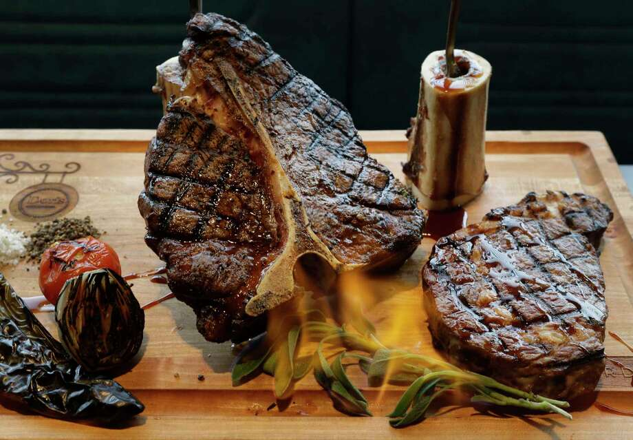 A meat board complete with flaming sage is shown at Doris Metropolitan, 2815 S. Shepherd, Wednesday, Dec. 6, 2017, in Houston.  ( Melissa Phillip / Houston Chronicle ) Photo: Melissa Phillip, Houston Chronicle / © 2017 Houston Chronicle
