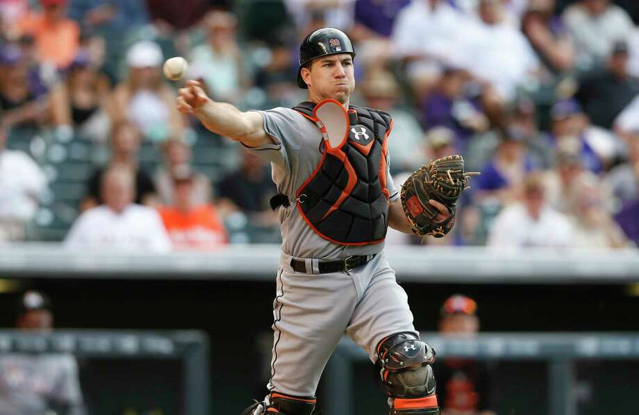 FILE - In this June 7, 2015, file photo, Miami Marlins catcher J.T. Realmuto throws to first base to put out Colorado Rockies first baseman Wilin Rosario in the ninth inning of a baseball game, in Denver. Photo: David Zalubowski, AP / Copyright 2017 The Associated Press. All rights reserved.