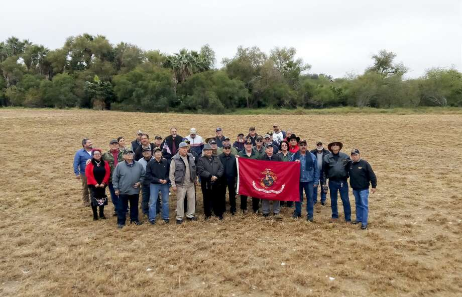 The Laredo Veterans Coalition, joined by City Councilman Charlie San Miguel, stand in an empty field where the group proposes the veterans museum be built. The field is located adjacent to North Central Park. Photo: Maria Salas/Laredo Morning Times