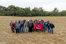 The Laredo Veterans Coalition, joined by City Councilman Charlie San Miguel, stand in an empty field where the group proposes the veterans museum be built. The field is located adjacent to North Central Park.
