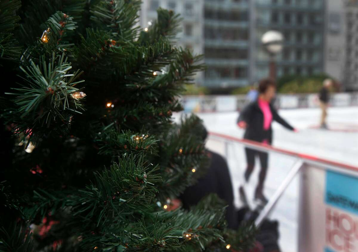 Lights twinkle in a Christmas tree next to the holiday ice skating rink at Union Square in San Francisco, Calif. on Friday, Nov. 3, 2017.