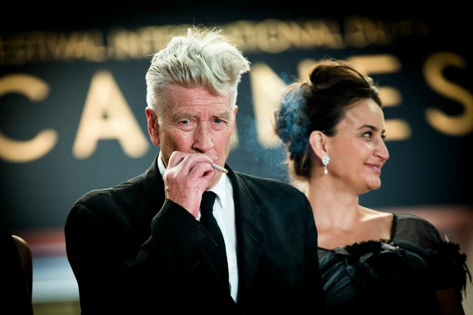 "Director David Lynch smokes as he departs the ""Twin Peaks"" screening during the 70th annual Cannes Film Festival at Palais des Festivals on May 25, 2017 in Cannes, France.  (Photo by Matthias Nareyek/Getty Images) Photo: Matthias Nareyek/Getty Images"