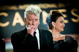 """CANNES, FRANCE - MAY 25:  Director David Lynch smokes as he departs the """"Twin Peaks"""" screening during the 70th annual Cannes Film Festival at Palais des Festivals on May 25, 2017 in Cannes, France.  (Photo by Matthias Nareyek/Getty Images)"""