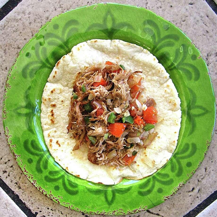 Carnitas a la mexicana taco on a handmade corn tortilla from Taco Nando. Photo: Mike Sutter /San Antonio Express-News