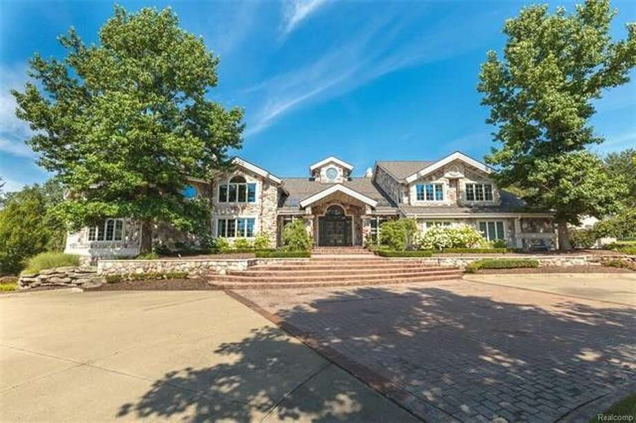 Eminem sold his 17,500-square-foot mansion in Rochester Hills, MI, for $1,900,000 in late September, less than half the $4.75 million he paid for it in 2003. Photo: Realtor.com