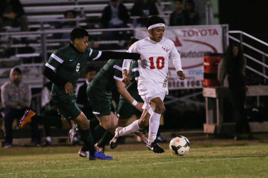 Caney Creek's Omar Quintana (10) moves the ball during the high school boys soccer game against Huntsville on Friday, Feb. 26, 2016, at Caney Creek High School. To view more photos from the game, go to HCNPics.com. Photo: Michael Minasi, Photographer / Internal
