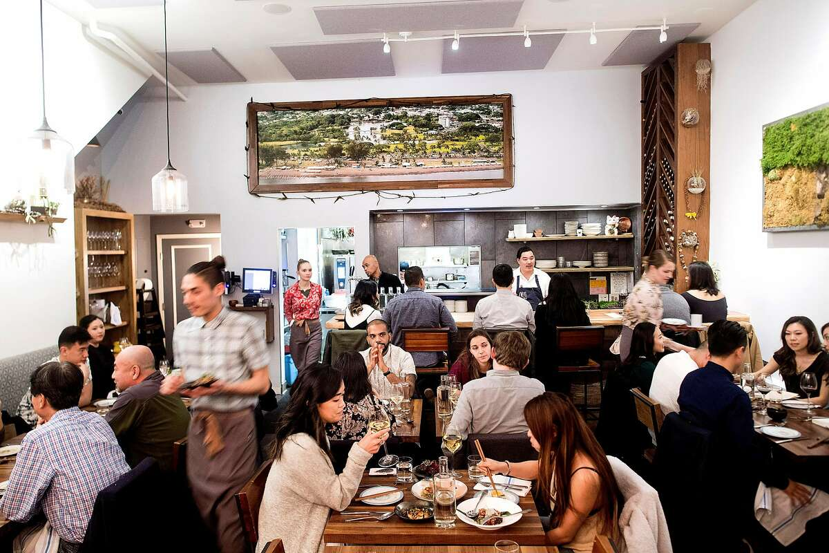 Diners eat at 'aina on Saturday, Dec. 16, 2017, in San Francisco.