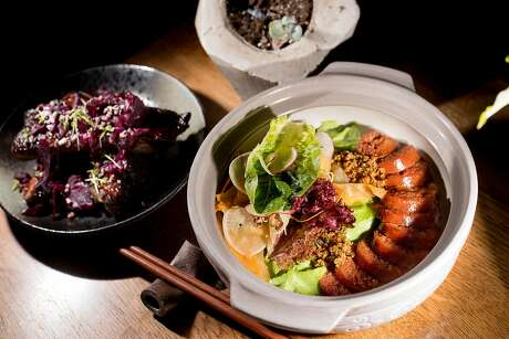 Kiawe smoked char siu ribs (left) and Portuguese butter bean cassoulet at 'Aina in S.F. Photo: Noah Berger, Special To The Chronicle