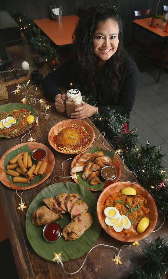 Chel Gilla, owner of Tselogs in Daly City, with Filipino food used in Nochebuena celebrations. Photo: Liz Hafalia, The Chronicle