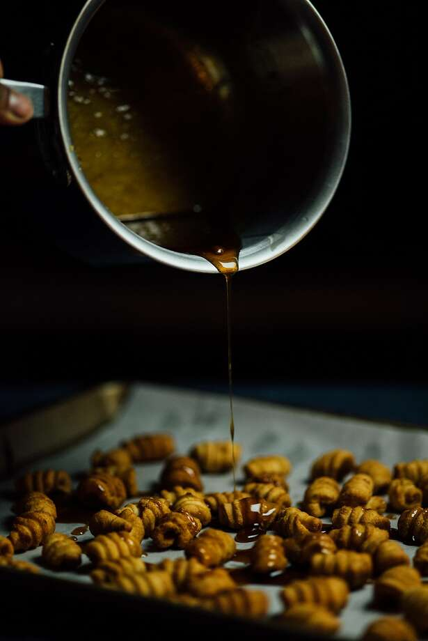 Pour the cardamom-maple syrup on the kulkuls. Photo: Nik Sharma