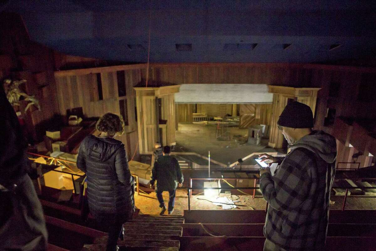 Scott Demel, Marvel's director, town engineer John Casey and Beth Daponte, the chairwoman of the Shakespeare Building Subcommittee, lead a half-dozen contractors on a rare tour through the long-shuttered American Shakespeare Festival Theatre on Elm Street in Stratford on Friday. The contractors will bebidding on the mothballing contract to secure the building from the elements, animals and the homeless.
