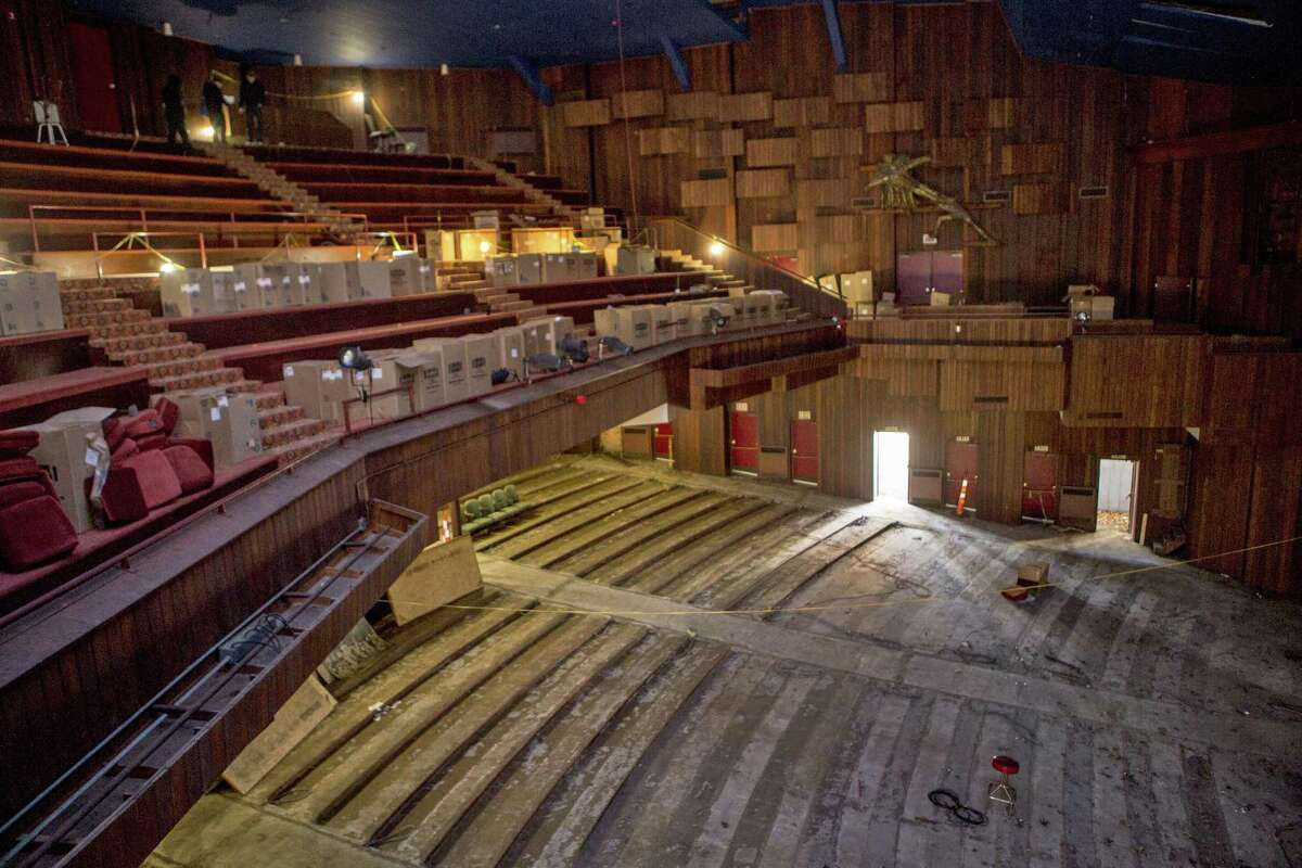 Scott Demel, Marvel's director, Town Engineer John Casey and Beth Daponte, the Chairman of the Shakespeare Building Subcommittee led a half-dozen contractors on a rare tour through the long-shuttered American Shakespeare Festival Theatre on Elm Street in Stratford, Conn. on Friday, Dec. 1, 2017. The contractors will bebidding on the mothballing contract to secure the building from the elements, animals and the homeless.