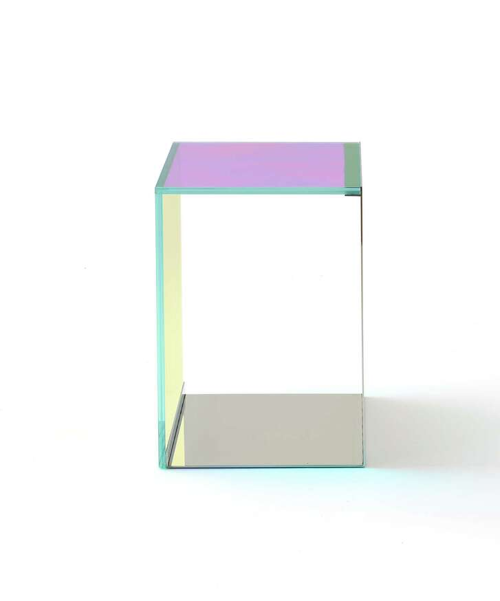 The Dichroic Table, part of the Rottet Collection, is made of dichroic glass and polished metal.