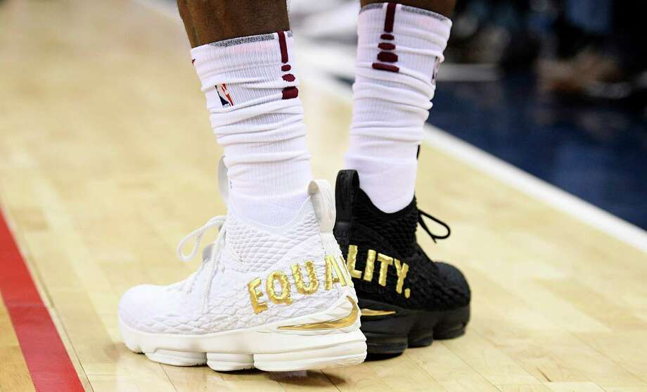 "Cleveland Cavaliers forward LeBron James' shoes are emblazoned with ""EQUALITY"" on both heels during the first half of an NBA basketball game against the Washington Wizards, Sunday, Dec. 17, 2017, in Washington. (AP Photo/Nick Wass) Photo: Nick Wass, FRE / FR67404 AP"