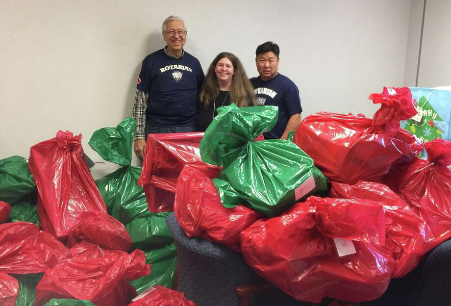 Katy Rotarians Rey Veselka and Scotty Jung delivered toys to Rhodes Elementary counselor Kathryn Johnson on Dec. 11. The Rotary Club collects toys each year before the holidays to share with area youngsters. From left are Veselka, Johnson and Jung. Photo: Rotary Club Of Katy