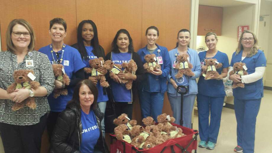"""A visit to the hospital isn't always a pleasant one, especially for children. However, a special teddy bear aims to help kids through the process with flying colors. United Airlines recently donated dozens of Adventure Bears named """"Ben Flyin"""" toMemorial Hermann Katy Hospital. The bears will be given to children as they undergo outpatient procedures, visit the emergency center, or are admitted to the hospital. This is the third year United Airlines has partnered with Memorial Hermann Katy for the Adventure Bear Program. Shown here aresome of the United Airlines volunteers, Memorial Hermann Katy staff, and the bears. Photo: Courtesy Photo"""