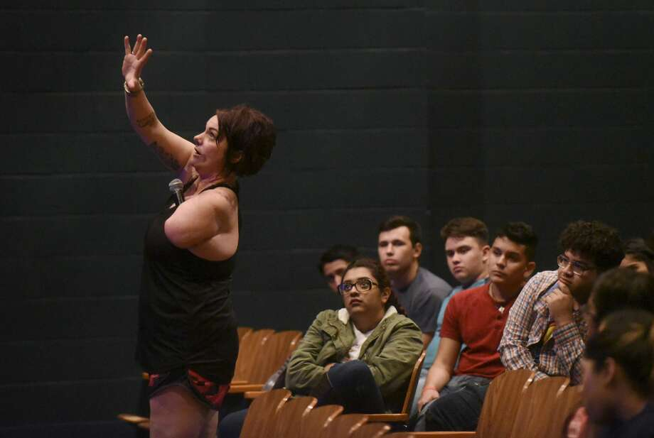 Sarah Panzau Evans, who lost an arm and suffered other serious injuries when she drove drunk and crashed in 2003, speaks to seniors at McCollum High School on Thursday, Nov. 2, 2017. She was a standout volleyball player in high school and had many college scholarship offers. One of her great regrets is putting her mother through the ordeal, she said. Photo: Billy Calzada