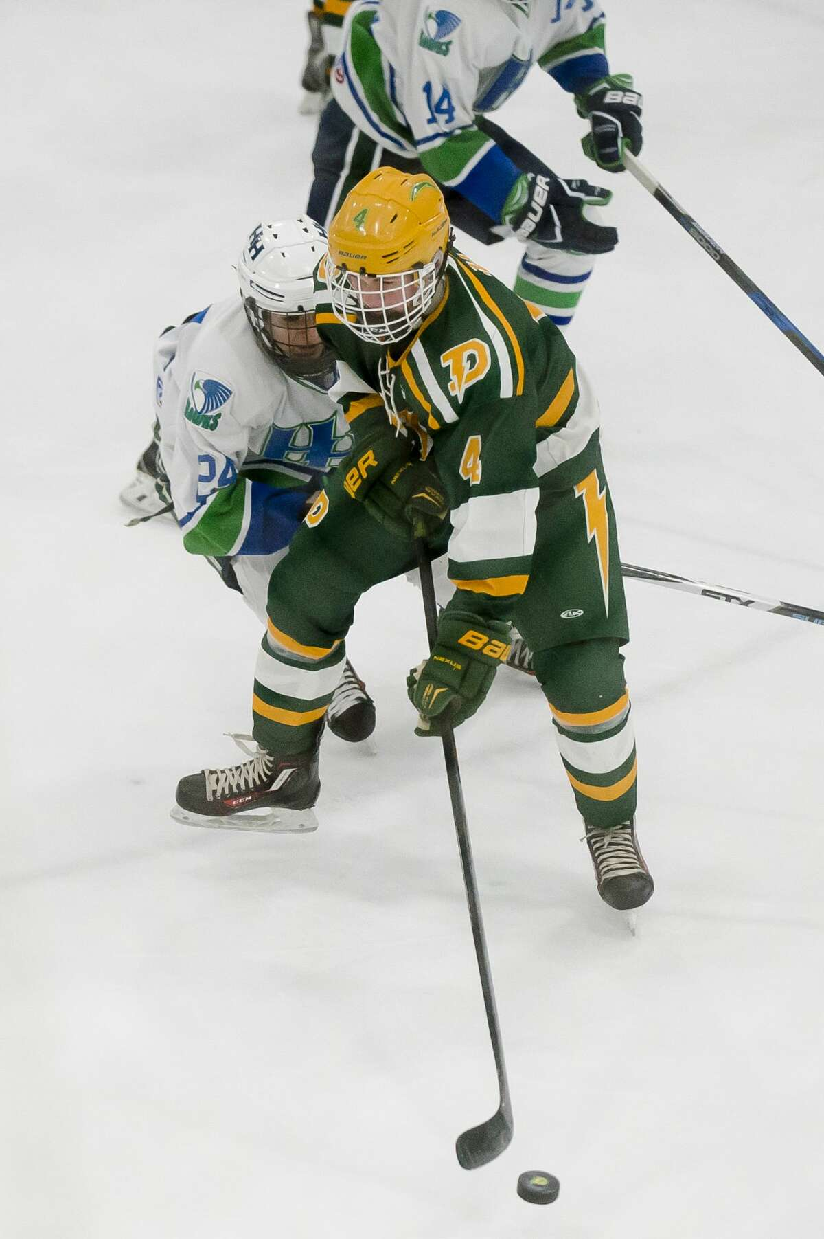Dow sophomore Zach Seipke maintains possession during the Charger's game against Saginaw Heritage on Monday, Dec. 18, 2017 at Midland Civic Arena. (Katy Kildee/kkildee@mdn.net)
