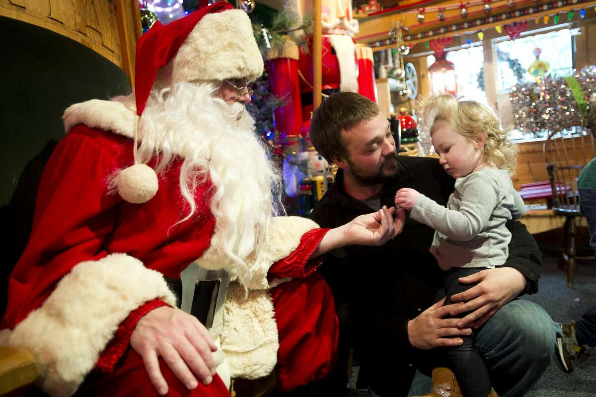 Children and families visit Santa Claus on Saturday, Dec. 16, 2017 at the Santa House in Midland. (Katy Kildee/kkilde@mdn.net)