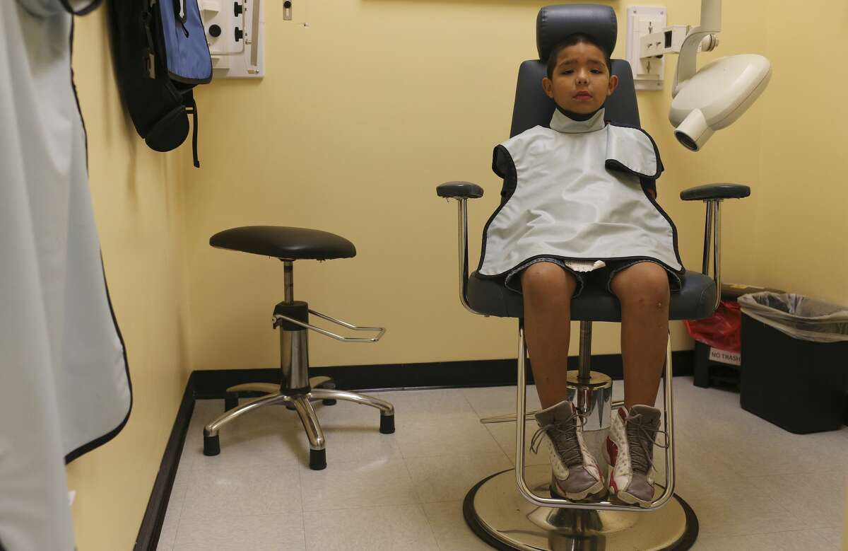 Louis Ramos, 8, waits for x-ray results during a free dental clinic at Kool Smiles General Dentistry for Kids, Sunday, May 21, 2017. The services were provided as part of the annual Sharing Smiles Day, offering uninsured and underinsured kids up to 18 free dental exams, extractions, restorative care and emergency care.