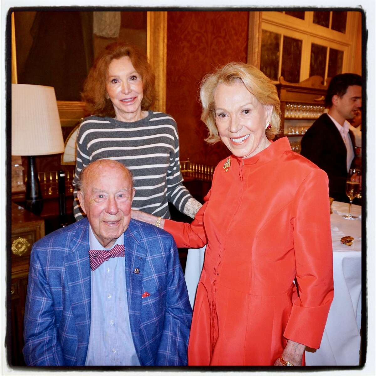 Ann Getty (center) celebrates the SF Consular Corps at a holiday party in her home with George and Charlotte Shultz.