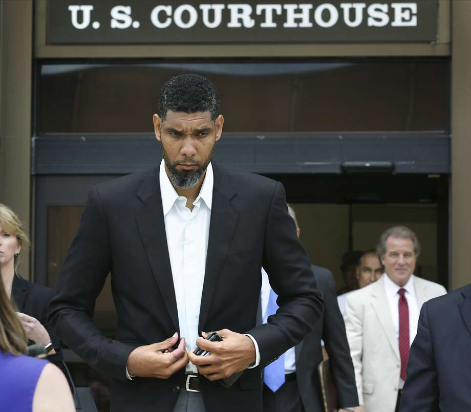 Retired Spurs player Tim Duncan, left, leaves the John H. Wood Jr. Federal Courthouse with his lawyers after the sentencing of his former financial advisor Charles Banks, on Wednesday, June 28, 2017. Photo: Bob Owen/San Antonio Express-News