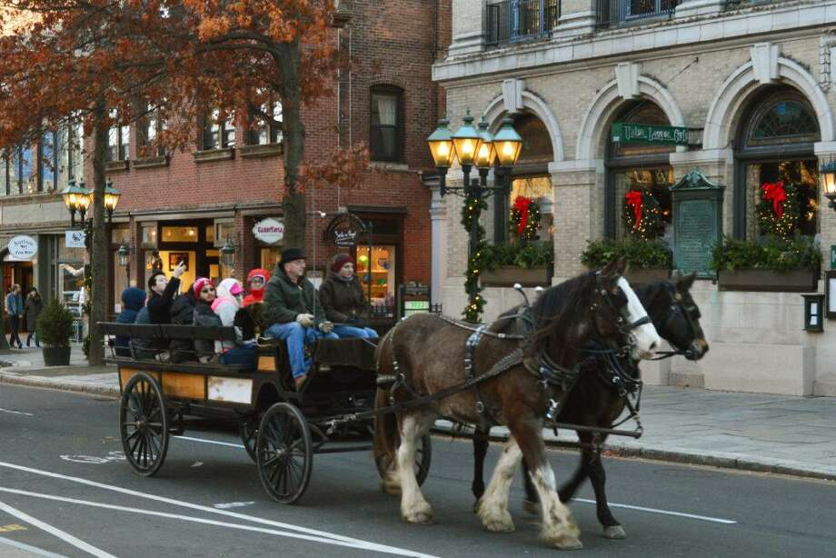 Free horse-and-carriage rides will be offered in downtown New Haven on Saturday, Dec. 23. Photo: Shops At Yale / Contributed Photo
