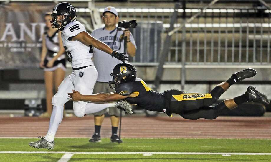 Knight running back Brenden Brady flies down the sideline on his way to a touchdown with Andrew Phillips unable to slow him down as Steele plays Brennan at Gustafson Stadium in the first round of 6A football playoffs  on November 17, 2017. Photo: Tom Reel/San Antonio Express-News