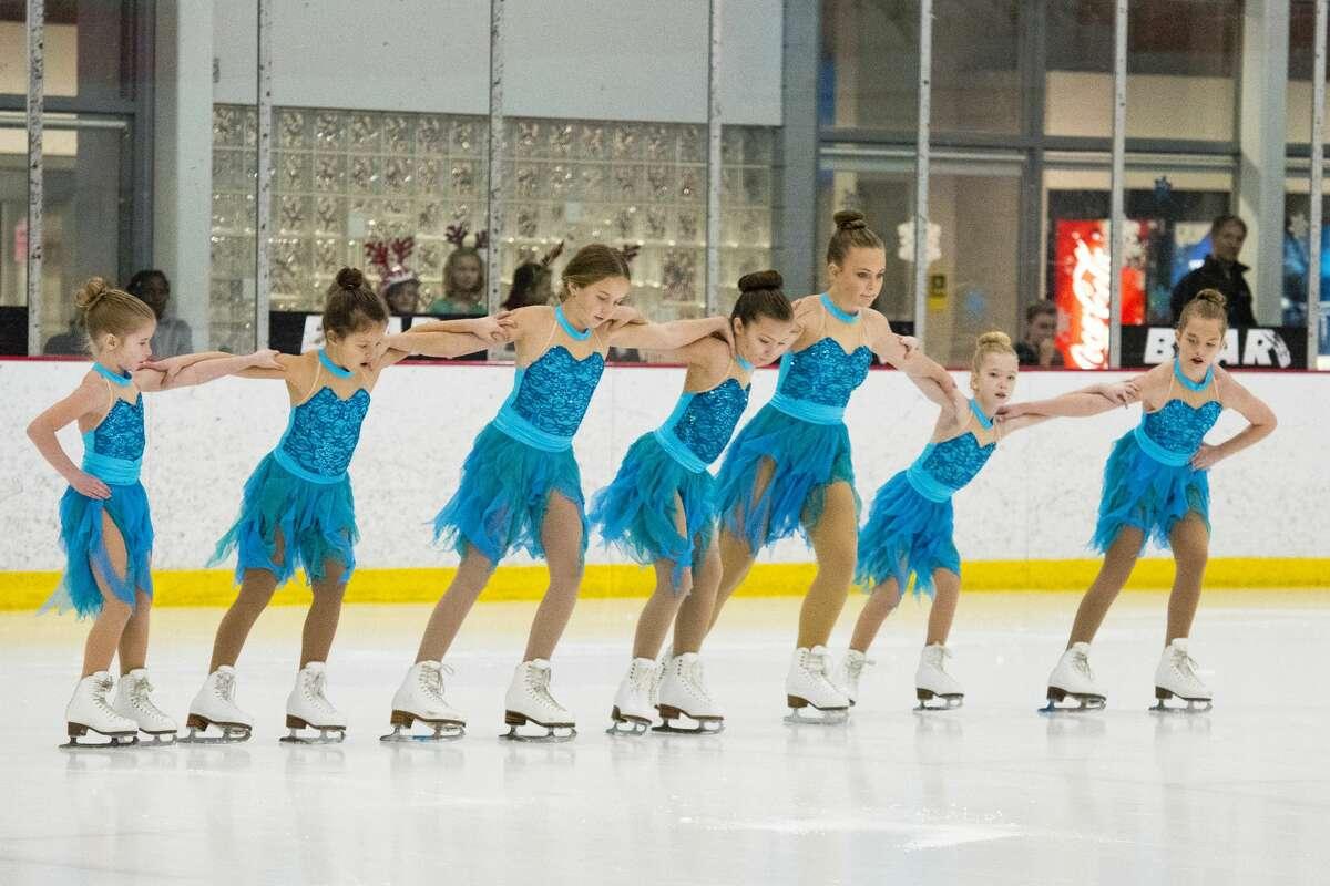 Ice Fusion, including Chloe Adam, Sera Dimuro, Brooke Dufresne, Claire Maclachlan, Kate Maclachlan, Phoebe McGough and Brooklyn Sturtz, skates to