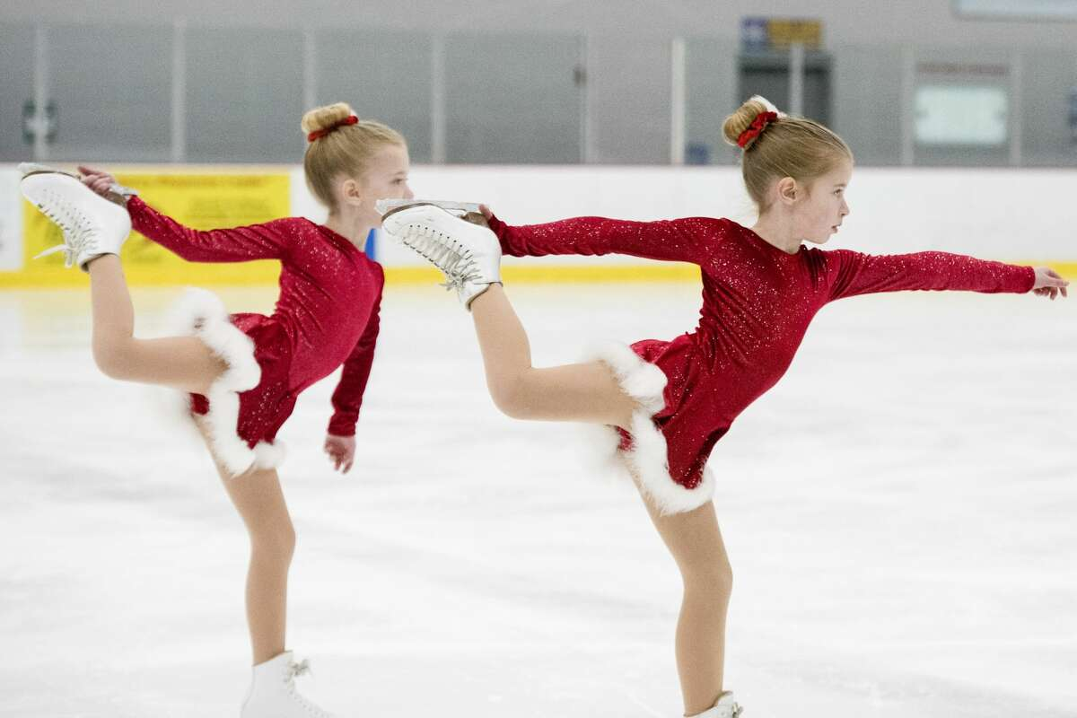 Claire Maclachlan and Kate Maclachlan skate to
