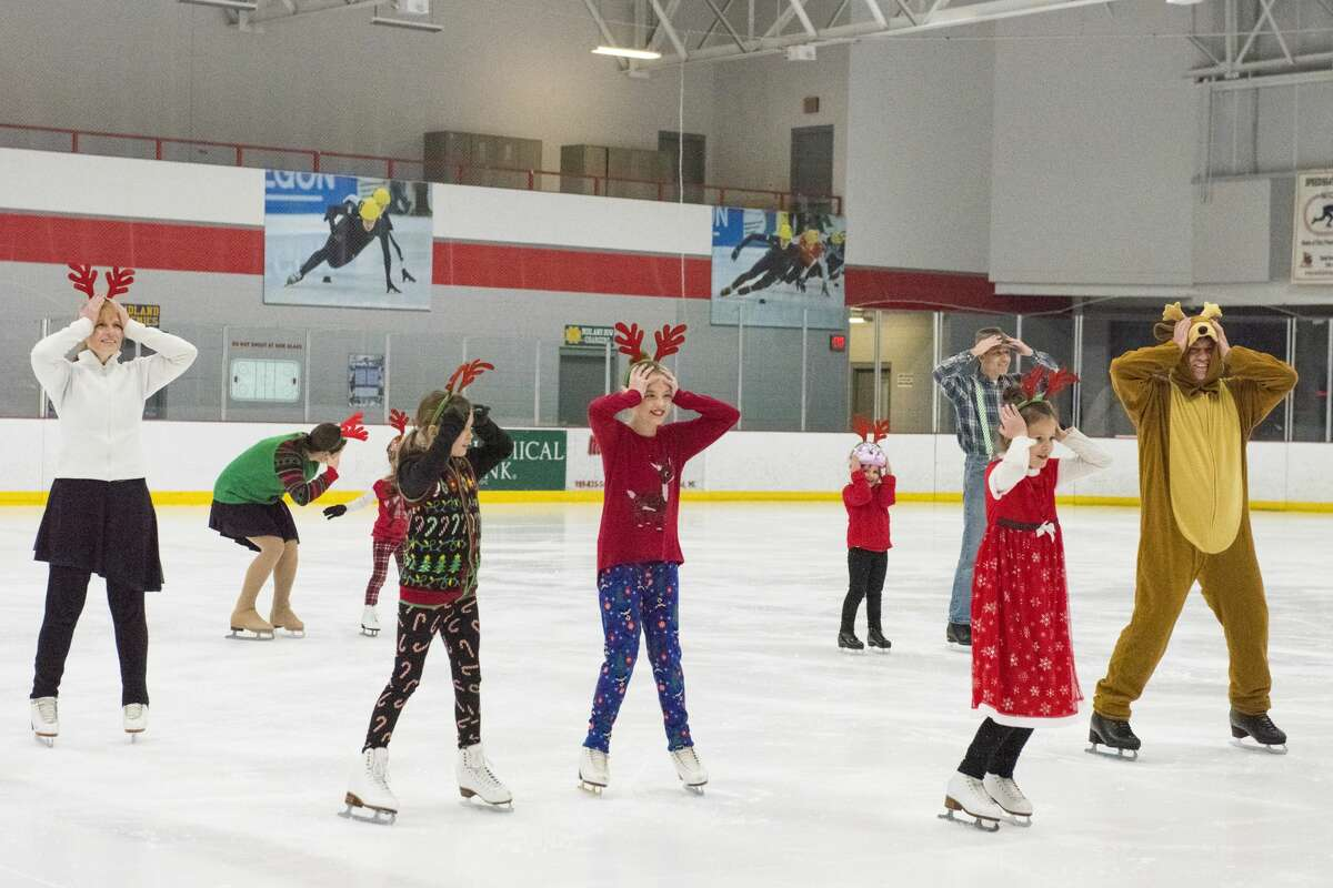 Members of Learn to Skate USA dance on ice to