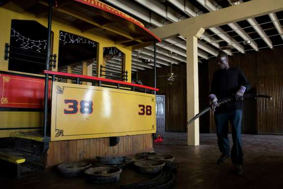 Troy Barlow stacks heavy pieces of metal bought by his employer at the Spaghetti Warehouse downtown location in Houston on Monday, Dec. 18, 2017.