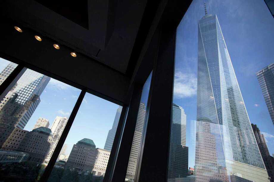 FILE - In this Aug. 15, 2016, file photo, window seating in the Eataly restaurant offers a view of One World Trade Center, right, in New York. Share prices were higher in Europe on Monday, Dec. 18, 2017, after a day of robust gains in Asia as investors anticipated passage of U.S. tax legislation that could boost corporate profits in the world's largest economy. (AP Photo/Mark Lennihan, File) Photo: Mark Lennihan, STF / Copyright 2016 The Associated Press. All rights reserved. This material may not be published, broadcast, rewritten or redistribu