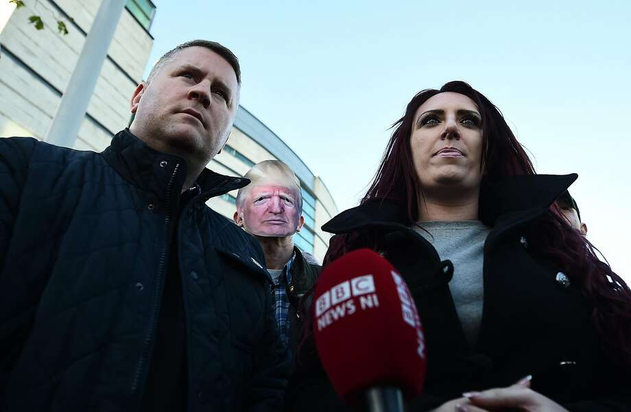 Britain First leader Paul Golding and deputy leader Jayda Fransen talk to the media outside Belfast Laganside Courts after Fransen was released on bail on Friday. Golding and Fransen had their Twitter accounts suspended Monday amid a crackdown on profiles advocating violence and hate. Photo: Charles McQuillan, Getty Images
