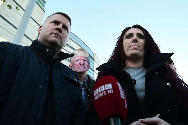 """BELFAST, NORTHERN IRELAND - DECEMBER 15: Britain First leader Paul Golding and deputy leader Jayda Fransen talk to the media outside Belfast Laganside Courts after Fransen was released on bail on December 15, 2017 in Belfast, Northern Ireland. Both Britain First leader Paul Golding and his deputy Fransen were arrested yesterday inside the court buildings on separate alleged offences. The Britain First deputy leader Jayda Fransen was initially in court to face a charge of using """"threatening, abusive or insulting words or behaviour"""" relating to a speech she made at a Northern Ireland Against Terrorism rally in Belfast earlier this year. Golding was arrested relating to a speech he made at the same rally. Fransen was re-arrested by PSNI officers in a matter relating to a video she posted about the Belfast Islamic Centre earlier this week. (Photo by Charles McQuillan/Getty Images)"""