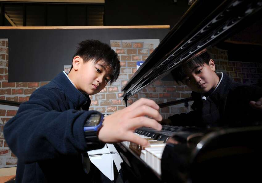 Whitby School 5th grade student Peter Liu, 10, plays the piano at the school in Greenwich, Conn., Friday, Jan. 6, 2017. Liu has been making a name for himself as a pianist, winning international awards.