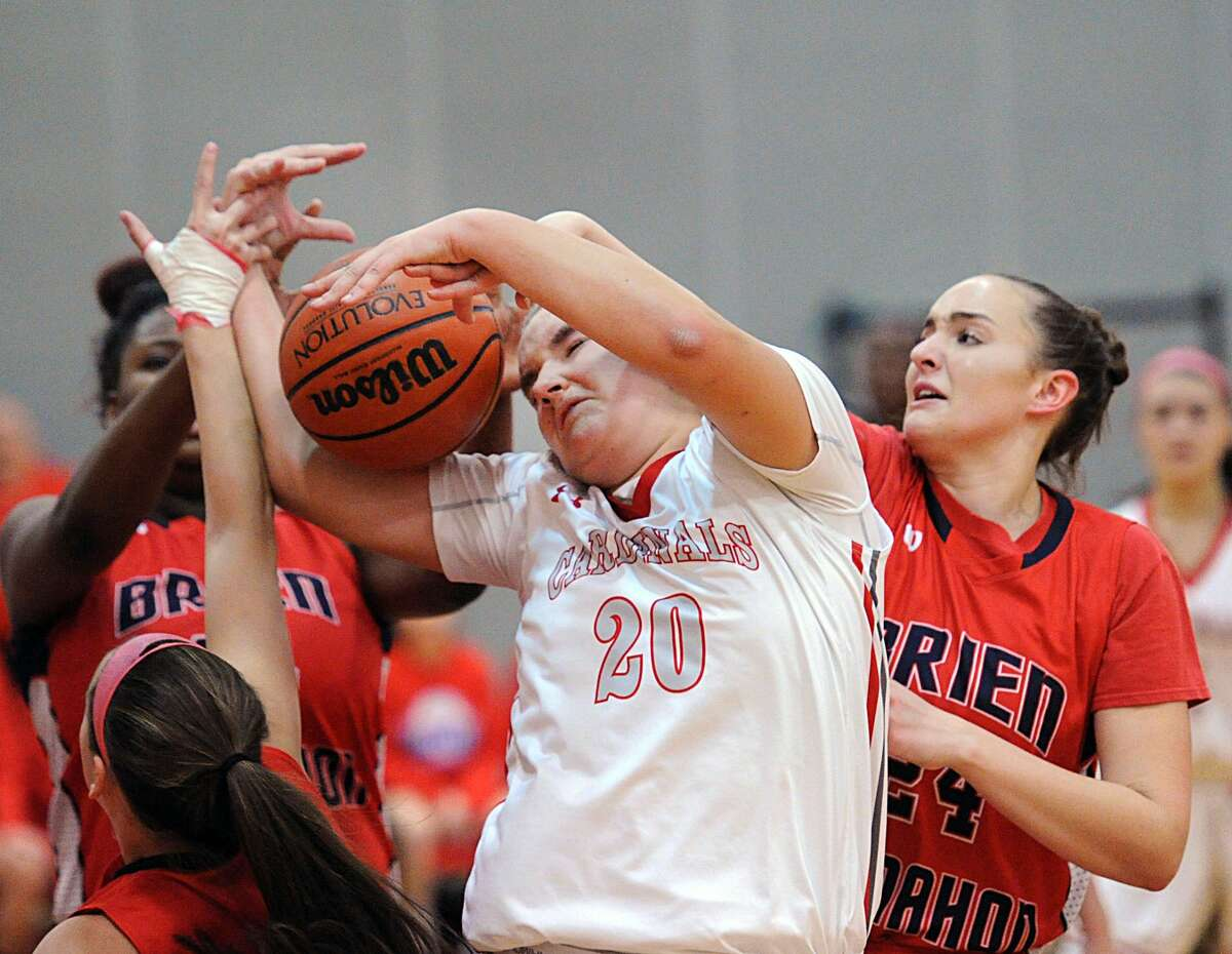 Emily Anderson (20) of Greenwich fights for a rebound aginst Brien McMahon's Carly Pinto (24), right, during the girls high scholl basketball game bewteen Greenwich High School and Brien McMahon High School at Greenwich, Conn., Friday, Jan. 6, 2017.